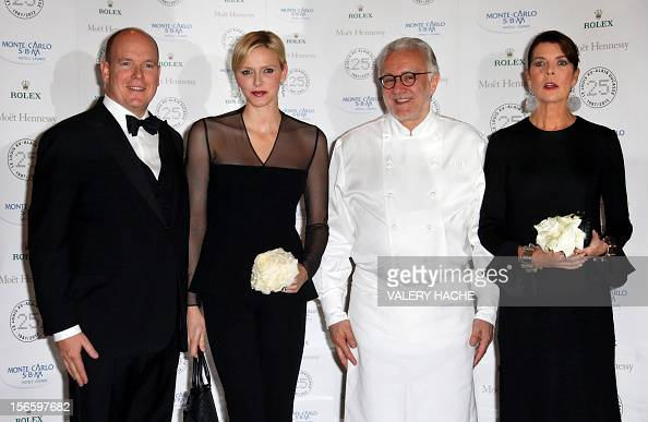 Prince Albert II of Monaco and his wife Princess Charlene French chef Alain Ducasse and Princess Caroline of Hanover pose during the festivities...