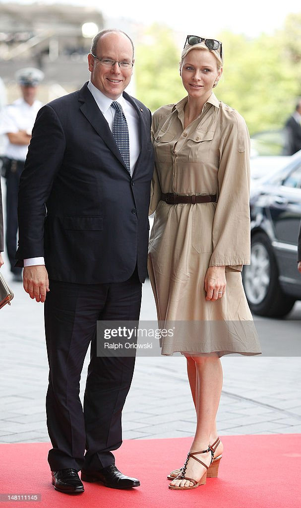 Prince Albert II of Monaco (L) and his wife Princess Charlene of Monaco arrive for a visit at the museum of German car manufacturer Mercedes-Benz on July 10, 2012 in Stuttgart, Germany.