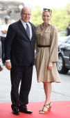 Prince Albert II of Monaco and his wife Princess Charlene of Monaco arrive for a visit at the museum of German car manufacturer MercedesBenz on July...