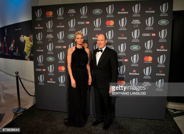 Prince Albert II of Monaco and his wife Princess Charlene of Monaco pose before attending World Rugby Awards on November 26 2017 in Monaco AFP PHOTO...
