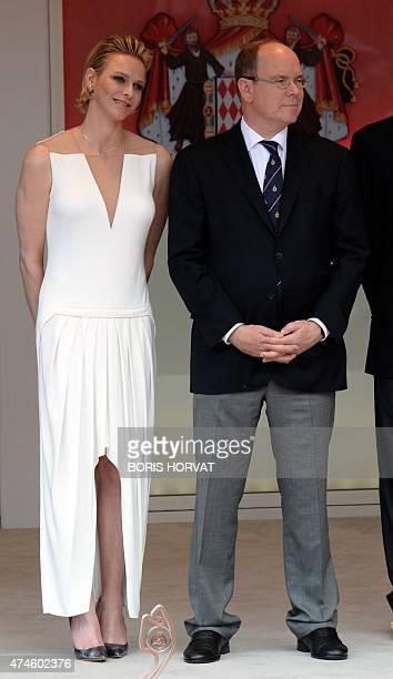 Prince Albert II of Monaco and his wife Princess Charlene stand on the podium during the Monaco Formula One Grand Prix at the Monaco street circuit...