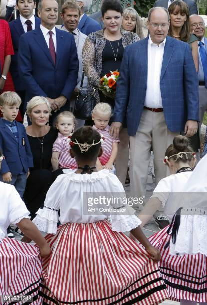Prince Albert II of Monaco and his wife Princess Charlene their twins Prince Jacques Princess Gabriella and an unidentified child take part in the...