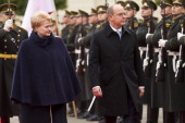 Prince Albert II of Monaco and Lithuania's President Dalia Grybauskaite review honor guard during a welcome ceremony in the President palace on...