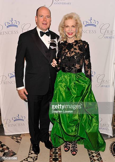 Prince Albert II of Monaco and Lynn Wyatt pose at the 30th anniversary Princess Grace awards gala at Cipriani 42nd Street on October 22 2012 in New...