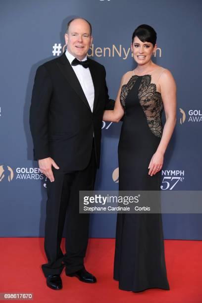 Prince Albert II of Monaco and Paget Brewster attend the 57th Monte Carlo TV Festival Closing Ceremony on June 20 2017 in MonteCarlo Monaco