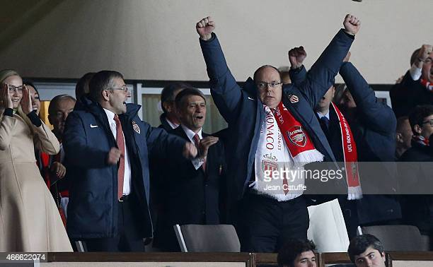 Prince Albert II of Monaco and President of AS Monaco Dmitri Rybolovlev celebrate the qualification of AS Monaco at final whistle of the UEFA...