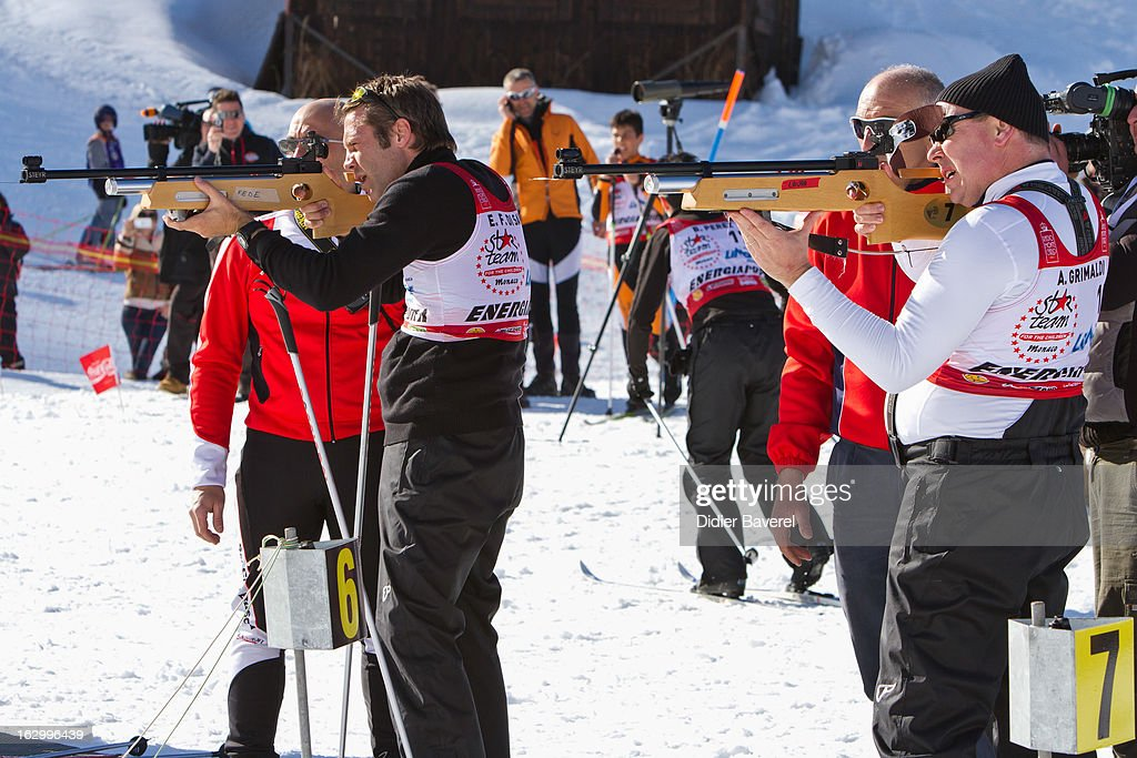 Prince Albert II of Monaco (R) and Prince Emmanuel-Philibert of Savoy (L) shoot during the Biatlhon Charity Ski Race To Collect Donations For 'Star Team For The Children MC' on March 2, 2013 in Limone, Italy.