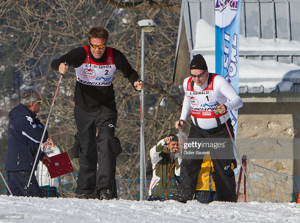 Prince Albert II of Monaco (R) and Prince Emmanuel-Philibert of Savoy (L) race during the Biatlhon Charity Ski Race To Collect Donations For 'Star Team For The Children MC' on March 2, 2013 in Limone, Italy.