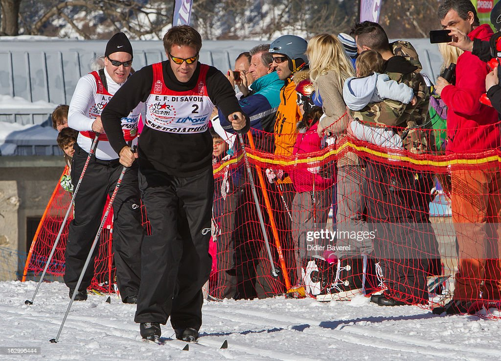 Prince Albert II of Monaco (L) and Prince Emmanuel-Philibert of Savoy (R) race during the Biatlhon Charity Ski Race To Collect Donations For 'Star Team For The Children MC' on March 2, 2013 in Limone, Italy.