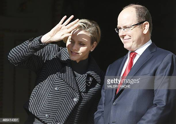 Prince Albert II of Monaco and Princess Charlene appear at the balcony of the Prince's palace during the SainteDevote festivities on January 27 2014...