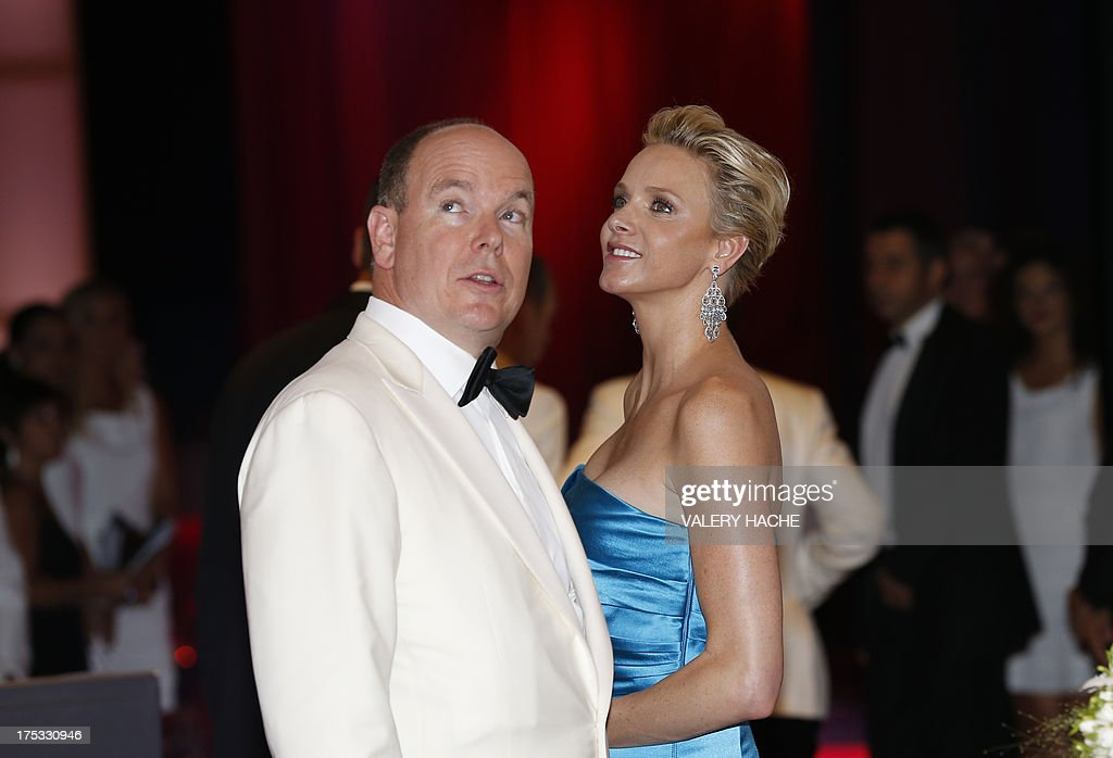 Prince Albert II of Monaco (L) and princess Charlene arrive to attend the 65th annual Red Cross Gala, on August 2, 2013, in Monaco. Created in 1948, the gala is an annual charity event held during the summer in Monaco by the Princely family.