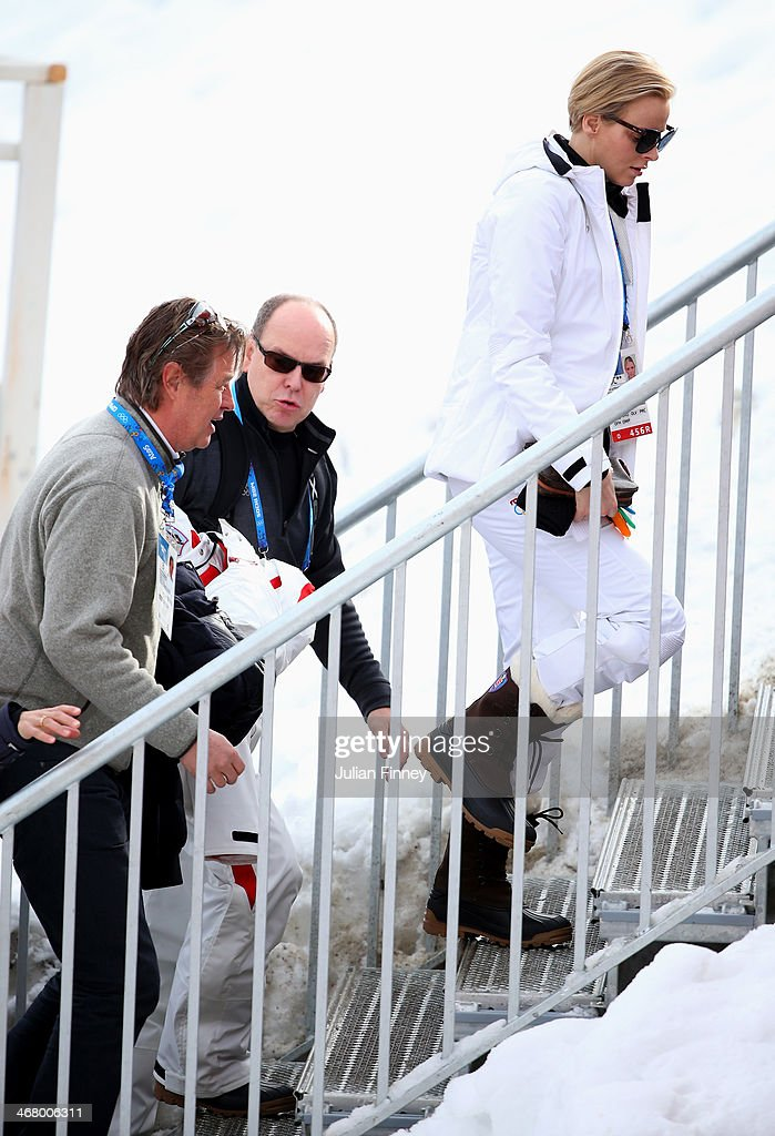 <a gi-track='captionPersonalityLinkClicked' href=/galleries/search?phrase=Prince+Albert+II+of+Monaco&family=editorial&specificpeople=201707 ng-click='$event.stopPropagation()'>Prince Albert II of Monaco</a> and Princess <a gi-track='captionPersonalityLinkClicked' href=/galleries/search?phrase=Charlene+-+Princess+of+Monaco&family=editorial&specificpeople=726115 ng-click='$event.stopPropagation()'>Charlene</a> of Monaco ahead of the Alpine Skiing Men's Downhill at Rosa Khutor Alpine Center on February 9, 2014 in Sochi, Russia.