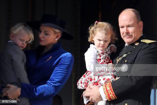 Prince Albert II of Monaco and Princess Charlene of Monaco appear with Prince Jacques and Princess Gabriella on the balcony of the Monaco Palace...