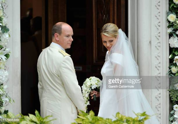 Prince Albert II of Monaco and Princess Charlene of Monaco arrive at Sainte Devote church after their religious wedding ceremony at the Prince's...