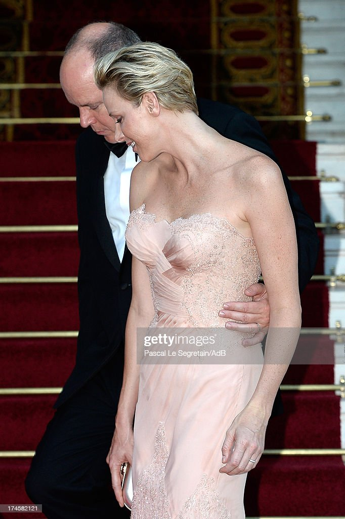 Prince Albert II of Monaco and Princess <a gi-track='captionPersonalityLinkClicked' href=/galleries/search?phrase=Charlene+-+Princesa+do+M%C3%B3naco&family=editorial&specificpeople=726115 ng-click='$event.stopPropagation()'>Charlene</a> of Monaco arrive at 'Love Ball' hosted by Natalia Vodianova in support of The Naked Heart Foundation at Opera Garnier on July 27, 2013 in Monaco, Monaco.