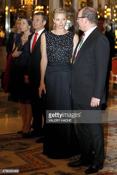 Prince Albert II of Monaco and Princess Charlene of Monaco arrive at the Hotel de Paris to attend the St David's Day gala dinner on March 1 2014 in...