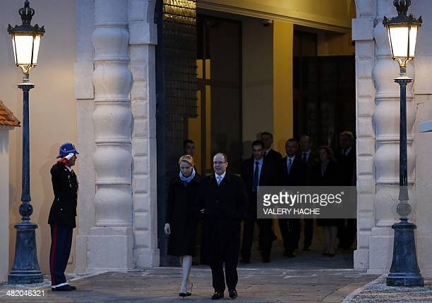 Prince Albert II of Monaco and Princess Charlene of Monaco arrive for the 'Push the button Palace in blue' event as part of the World Autism...