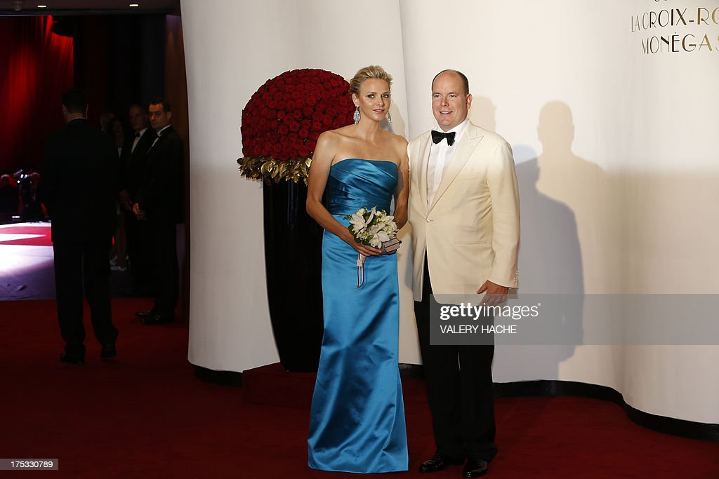 Prince Albert II of Monaco and Princess Charlene of Monaco arrive to attend the 65th annual Red Cross Gala, on August 2, 2013, in Monaco. Created in 1948, the gala is an annual charity event held in Monaco by its Princely Family during the summer. AFP PHOTO / VALERY HACHE