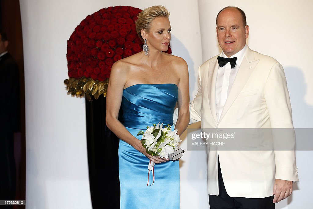 Prince Albert II of Monaco and Princess Charlene of Monaco arrive to attend the 65th annual Red Cross Gala, on August 2, 2013, in Monaco. Created in 1948, the gala is an annual charity event held in Monaco by its Princely Family during the summer.