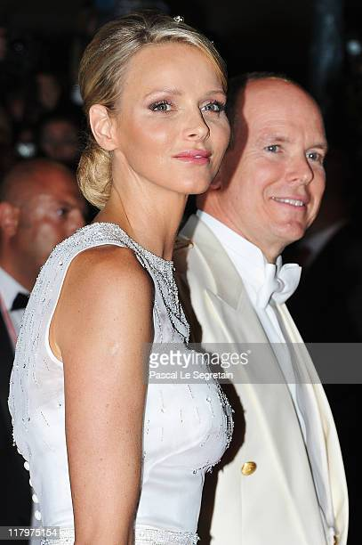 Prince Albert II of Monaco and Princess Charlene of Monaco attend a dinner at Opera terraces after their religious wedding ceremony on July 2 2011 in...
