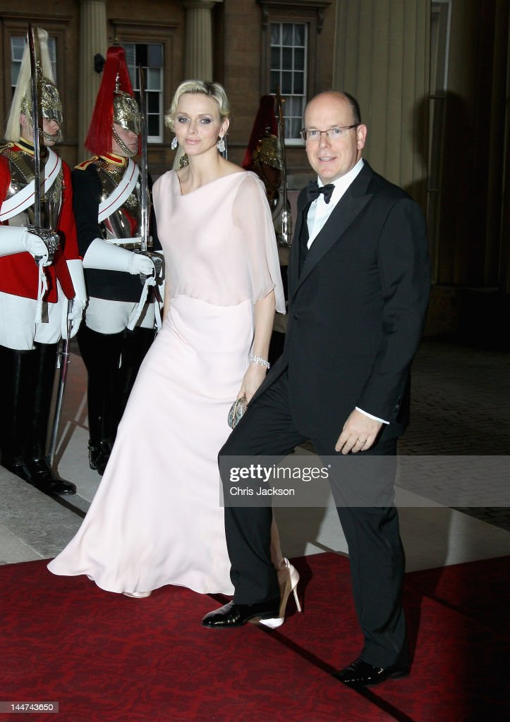 <a gi-track='captionPersonalityLinkClicked' href=/galleries/search?phrase=Prince+Albert+II+of+Monaco&family=editorial&specificpeople=201707 ng-click='$event.stopPropagation()'>Prince Albert II of Monaco</a> and Princess <a gi-track='captionPersonalityLinkClicked' href=/galleries/search?phrase=Charlene+-+Princess+of+Monaco&family=editorial&specificpeople=726115 ng-click='$event.stopPropagation()'>Charlene</a> of Monaco attend a dinner for foreign Sovereigns to commemorate the Diamond Jubilee at Buckingham Palace on May 18, 2012 in London, England. Prince Charles, Prince of Wales and Camilla, Duchess of Cornwall hosted the event.