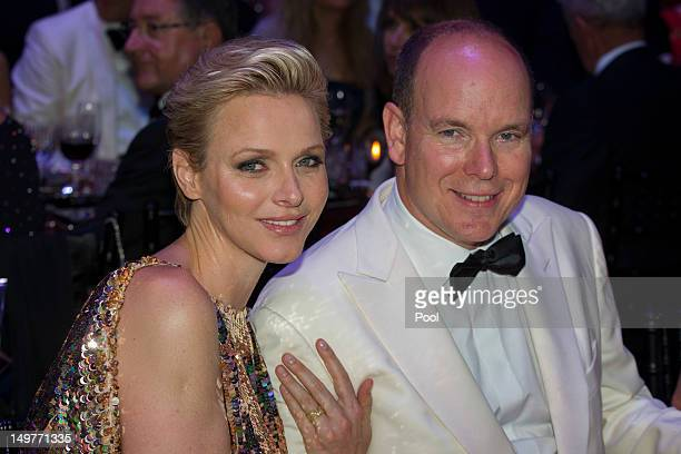 Prince Albert II of Monaco and Princess Charlene of Monaco attend 64th Red Cross Ball Gala in Salle des Etoiles at Sporting MonteCarlo on August 3...
