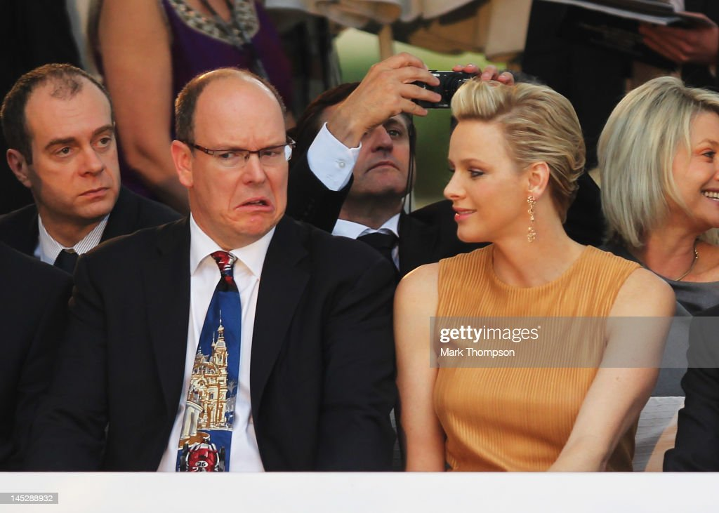 <a gi-track='captionPersonalityLinkClicked' href=/galleries/search?phrase=Prince+Albert+II+of+Monaco&family=editorial&specificpeople=201707 ng-click='$event.stopPropagation()'>Prince Albert II of Monaco</a> and Princess <a gi-track='captionPersonalityLinkClicked' href=/galleries/search?phrase=Charlene+-+Princess+of+Monaco&family=editorial&specificpeople=726115 ng-click='$event.stopPropagation()'>Charlene</a> of Monaco attend the Amber Fashion Show and Charity Auction at Le Meridien Beach Plaza Hotel on May 25, 2012 in Monaco, Monaco.