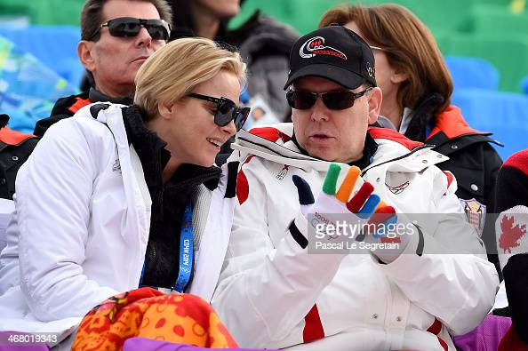Prince Albert II of Monaco and Princess Charlene of Monaco attend the Alpine Skiing Men's Downhill at Rosa Khutor Alpine Center on February 9 2014 in...