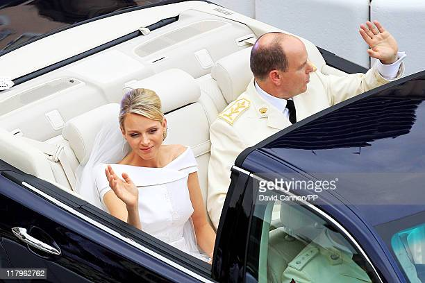Prince Albert II of Monaco and Princess Charlene of Monaco depart from Sainte Devote church after their religious wedding ceremony at the Prince's...
