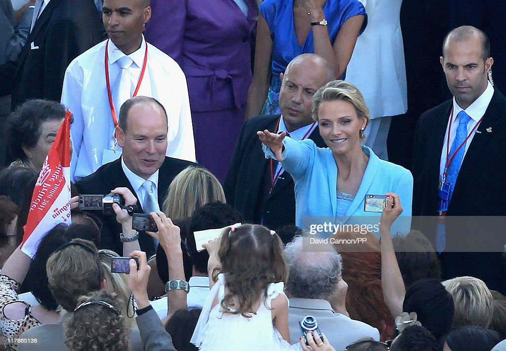 Prince Albert II of Monaco and Princess Charlene of Monaco greet well wishers after the civil ceremony of their Royal Wedding at the Prince's Palace on July 1, 2011 in Monaco. The ceremony took place in the Throne Room of the Prince's Palace of Monaco, followed by a religious ceremony to be conducted in the main courtyard of the Palace on July 2. With her marriage to the head of state of Principality of Monaco, Charlene Wittstock has become Princess consort of Monaco and gain the title, Princess Charlene of Monaco. Celebrations including concerts and firework displays are being held across several days, attended by a guest list of global celebrities and heads of state.