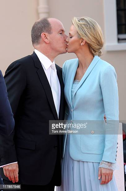 Prince Albert II of Monaco and Princess Charlene of Monaco kiss after the civil ceremony of the Royal Wedding of Prince Albert II of Monaco to...