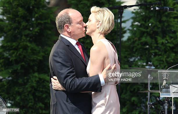 Prince Albert II of Monaco and Princess Charlene of Monaco kiss during celebrations marking Prince Albert II's decade on the throne on July 11 2015...