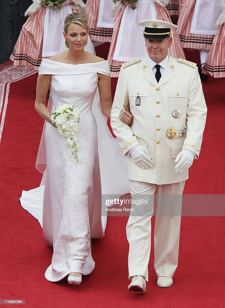 <a gi-track='captionPersonalityLinkClicked' href=/galleries/search?phrase=Prince+Albert+II+of+Monaco&family=editorial&specificpeople=201707 ng-click='$event.stopPropagation()'>Prince Albert II of Monaco</a> and Princess <a gi-track='captionPersonalityLinkClicked' href=/galleries/search?phrase=Charlene+-+Princess+of+Monaco&family=editorial&specificpeople=726115 ng-click='$event.stopPropagation()'>Charlene</a> of Monaco leave their religious wedding ceremony in the main courtyard at the Prince's Palace on July 2, 2011 in Monaco. The Roman-Catholic ceremony follows the civil wedding which was held in the Throne Room of the Prince's Palace of Monaco on July 1. With her marriage to the head of state of the Principality of Monaco, <a gi-track='captionPersonalityLinkClicked' href=/galleries/search?phrase=Charlene+-+Princess+of+Monaco&family=editorial&specificpeople=726115 ng-click='$event.stopPropagation()'>Charlene</a> Wittstock has become Princess consort of Monaco and gains the title, Princess <a gi-track='captionPersonalityLinkClicked' href=/galleries/search?phrase=Charlene+-+Princess+of+Monaco&family=editorial&specificpeople=726115 ng-click='$event.stopPropagation()'>Charlene</a> of Monaco. Celebrations including concerts and firework displays are being held across several days, attended by a guest list of global celebrities and heads of state.