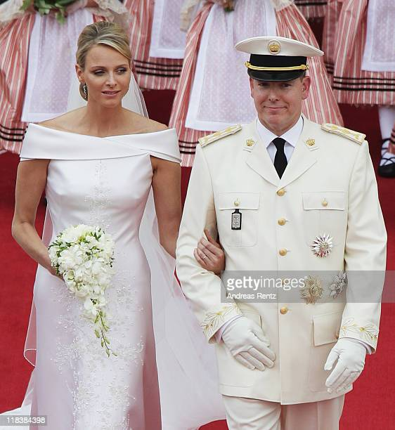 Prince Albert II of Monaco and Princess Charlene of Monaco leave their religious wedding ceremony in the main courtyard at the Prince's Palace on...
