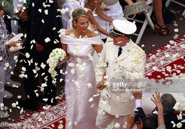 Prince Albert II of Monaco and Princess Charlene of Monaco leave the palace after the religious ceremony of the Royal Wedding at the Prince's Palace...