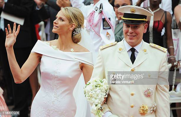 Prince Albert II of Monaco and Princess Charlene of Monaco leave the religious wedding ceremony at the Prince's Palace of Monaco on July 2 2011 in...