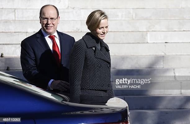 Prince Albert II of Monaco and princess Charlene of Monaco leave the Monaco Cathedral during the SainteDevote festivities on January 27 2014 in...