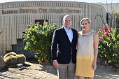 Prince Albert II of Monaco and Princess Charlene of Monaco pose as they arrive to attend a visit to the Barbara Sinatra Children's Center on October...