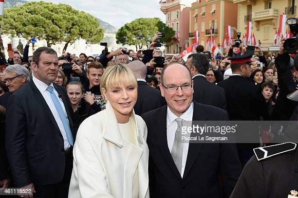 Prince Albert II of Monaco and Princess Charlene of Monaco pose as they gather with the crowd on January 7 2015 in Monaco Monaco
