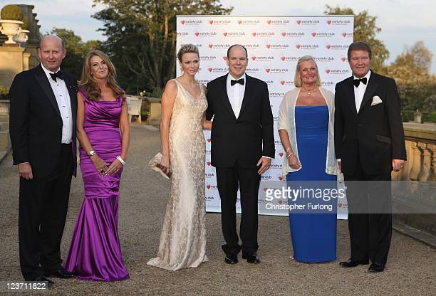 Prince Albert II of Monaco and Princess Charlene of Monaco pose with David Wilson chairman Yorkshire Variety his wife Gail Stephen Bolton Ball...