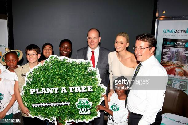 Prince Albert II of Monaco and Princess Charlene of Monaco pose with members of the Stop Talking Start Planting team attend the Climate Action...