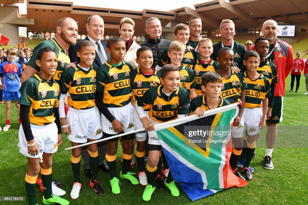 Prince Albert II of Monaco and Princess Charlene of Monaco pose with the Under-12 Rugby team of Cap Town, South Africa during the Sainte Devote Rugby Tournament on March 18, 2017 in Monte-Carlo, Monaco.