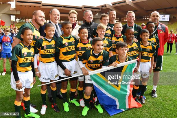 Prince Albert II of Monaco and Princess Charlene of Monaco pose with the Under12 Rugby team of Cap Town South Africa during the Sainte Devote Rugby...