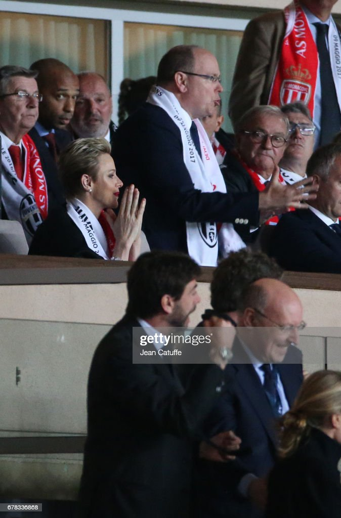 Prince Albert II of Monaco and Princess Charlene of Monaco react after the second goal of Juventus while President of Juventus Andrea Agnelli (below) celebrates and Thierry Henry (top left) looks on during the UEFA Champions League semi final first leg match between AS Monaco and Juventus Turin at Stade Louis II on May 3, 2017 in Monaco, Monaco.
