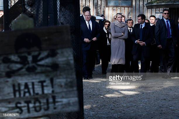 Prince Albert II of Monaco and Princess Charlene of Monaco walk through the AuschwitzBirkenau Museum during a state visit on October 19 2012 in...