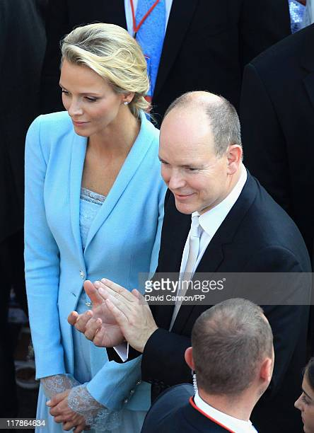 Prince Albert II of Monaco and Princess Charlene of Monaco watch dancers perform after the civil ceremony of their Royal Wedding at the Prince's...