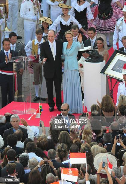 Prince Albert II of Monaco and Princess Charlene of Monaco wave to well wishers after the civil ceremony of their Royal Wedding at the Prince's...