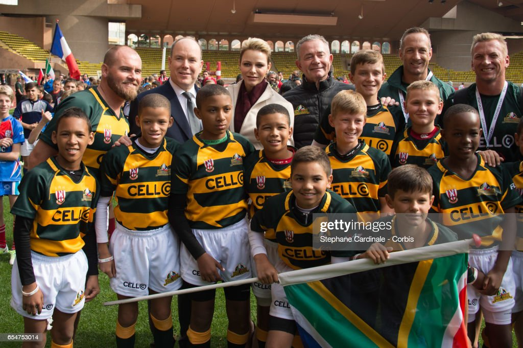 Prince Albert II of Monaco and Princess Charlene of Monaco with the Under-12 Rugby team of Cap Town, South Africa during the Sainte Devote Rugby Tournament on March 18, 2017 in Monte-Carlo, Monaco.