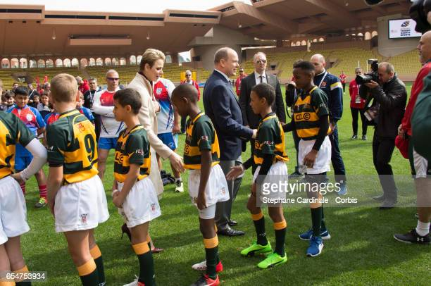 Prince Albert II of Monaco and Princess Charlene of Monaco with the Under12 Rugby team of Cap Town South Africa during the Sainte Devote Rugby...