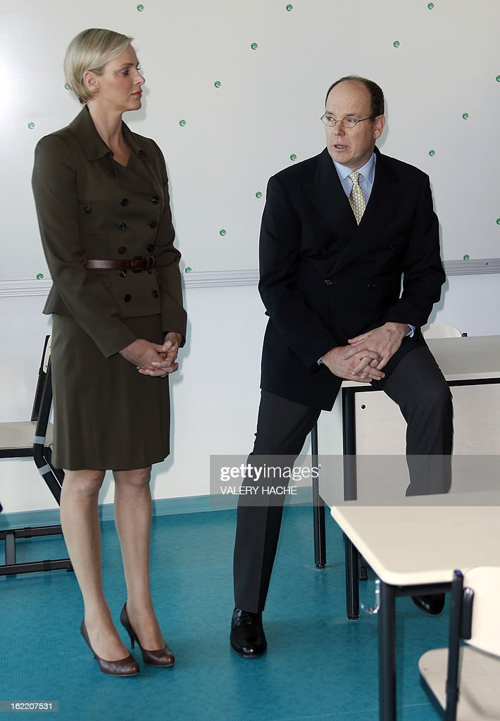 Prince Albert II of Monaco and Princess Charlene visit a classroom of the new 'Lycee Technique et Hotelier de Monaco' (Vocational school for hotel and catering) on February 20, 2013 in Monaco. AFP PHOTO / VALERY HACHE